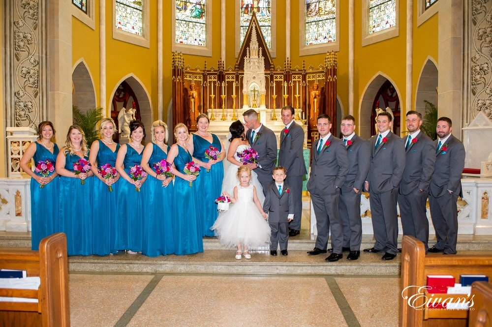 The bridal party stand so beautifully together at the front of the alter showing off this moment of pure happiness.