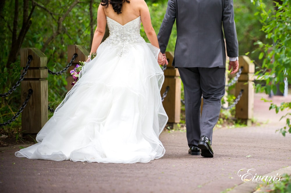 The couple's hold hands as they walk into the new part of their life.