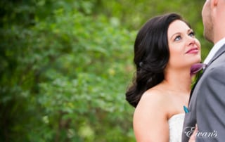 The bride gazes into her groom's eyes falling in love all over again.