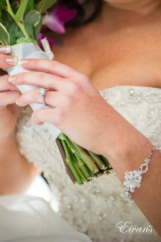 The bride shows of her new wedding ring that solidifies her love forever.