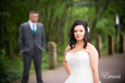 The bride looks absolutely effortless while standing in front of her groom.