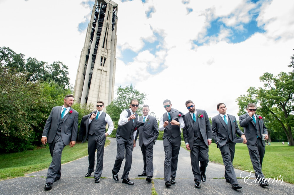 The groom and his groomsmen celebrate and cheer lots for this perfect day.
