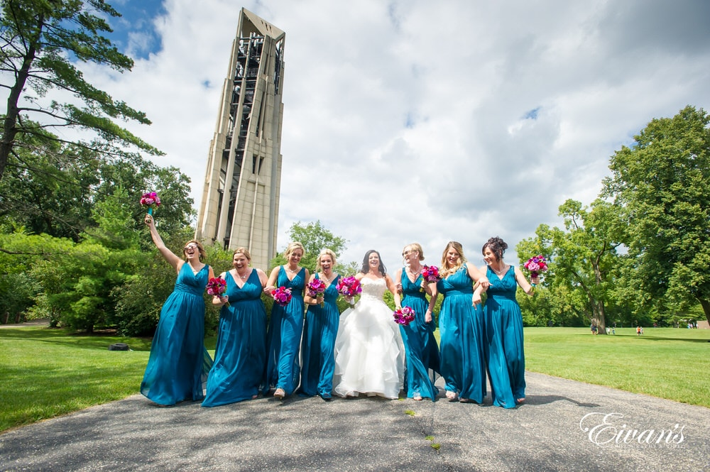 The bride and her bridesmaids celebrate shining in such an amazing scenery.