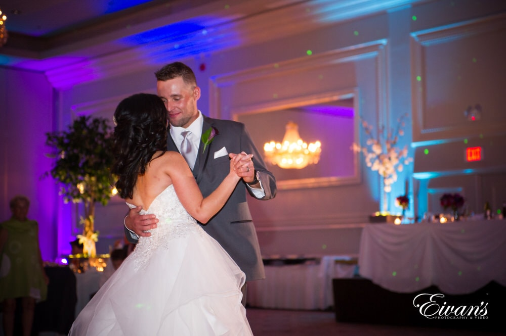 The couple share their first dance together in a moment of love and happiness.