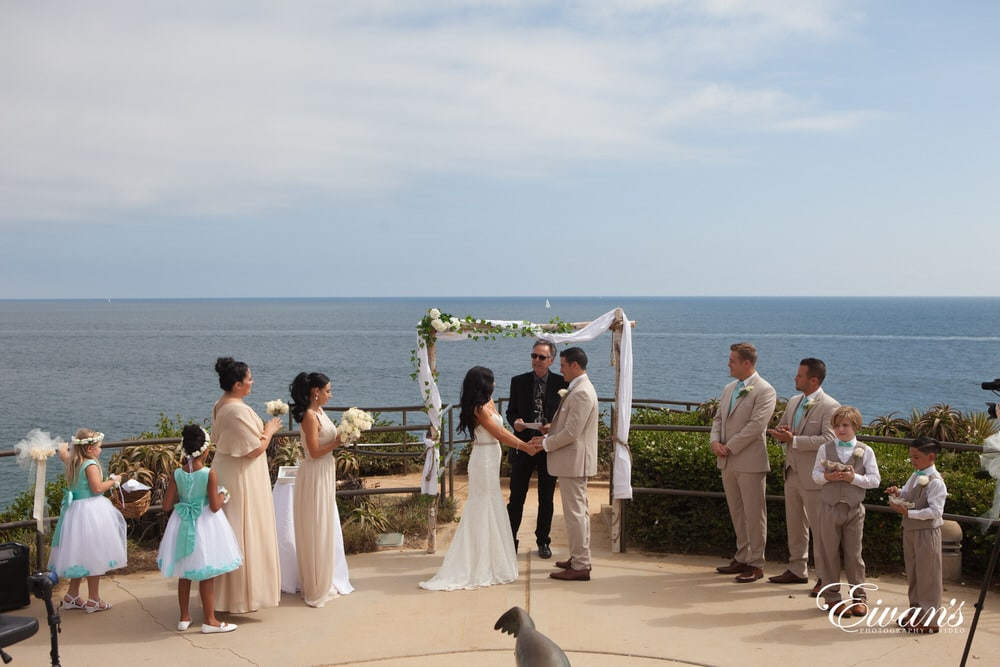 The couple stand together at the alter ready to begin their new life's together simply in love with one another.