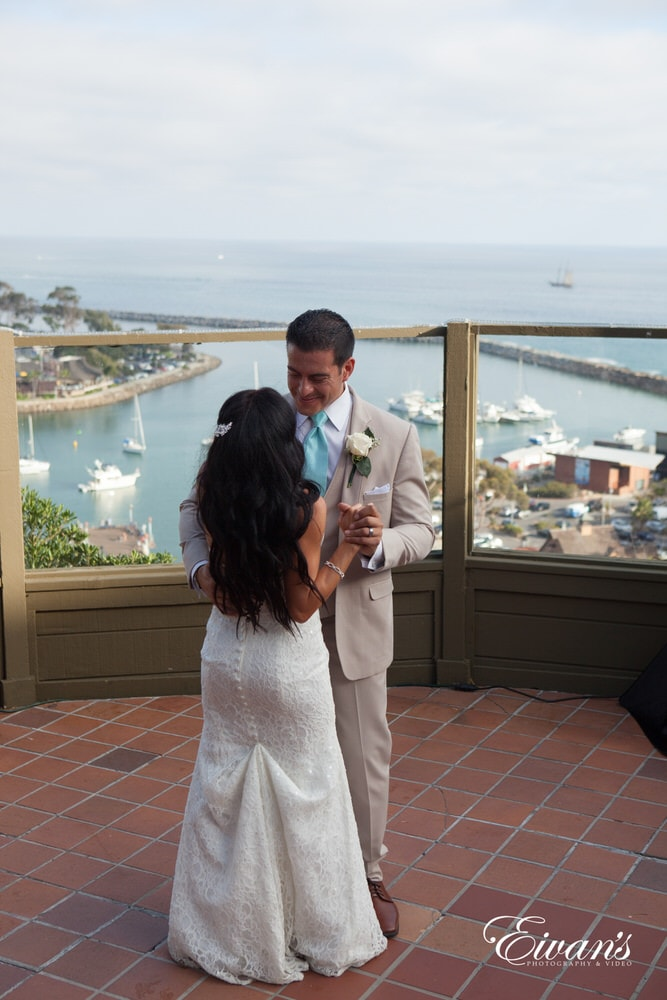 The groom and bride have their first dance together overlooking this spectacular location.