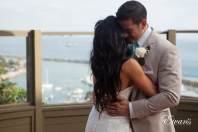The groom embraces the love of his life entirely invested in this moment that he will remember for the rest of his life.