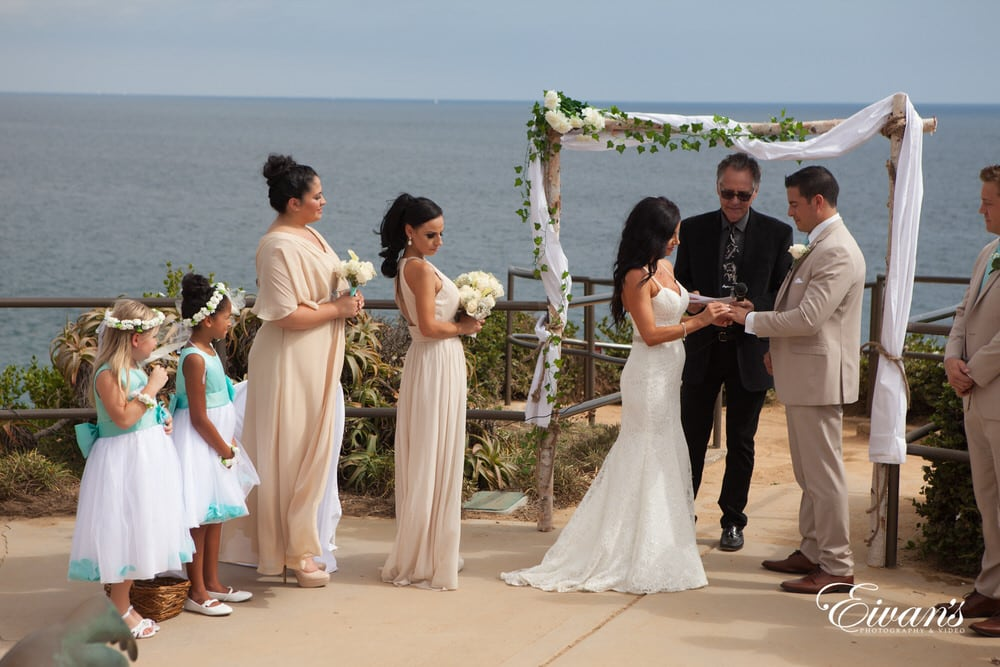 The couple stand at the alter solidifying their love forever with a few words, rings, and one unforgettable kiss.