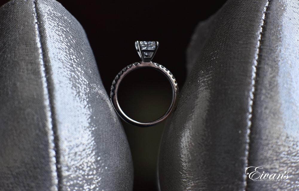 The bride's ring is placed between the bride's heels showing her love.