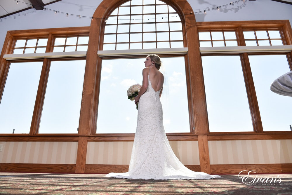 The bride looks absolutely perfect in her outstanding wedding ensemble