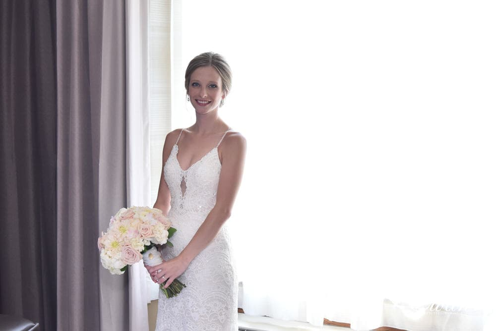 The bride looks truly beautiful awaiting her moment to walk down the isle to the love of her life.
