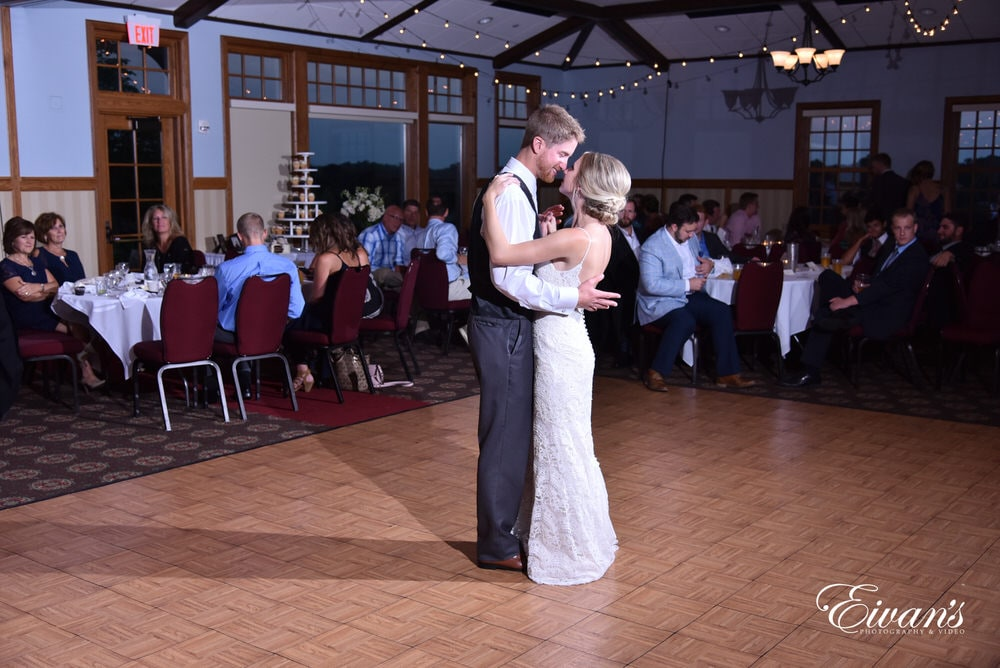 The couple share their first dance in moments of love and happiness.