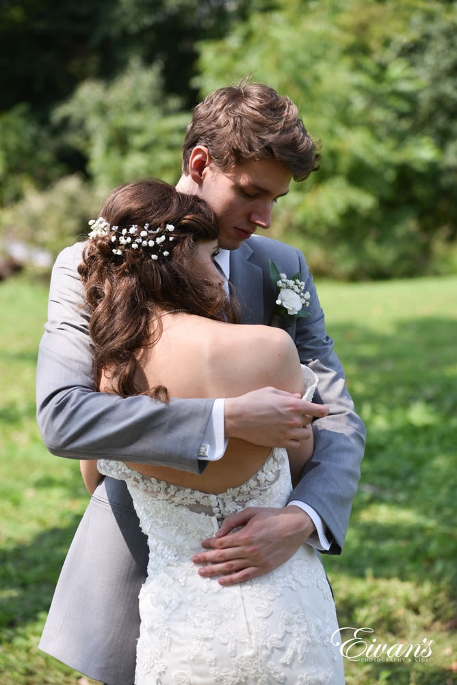The groom holds the love of his life simply enjoying the company of one another.