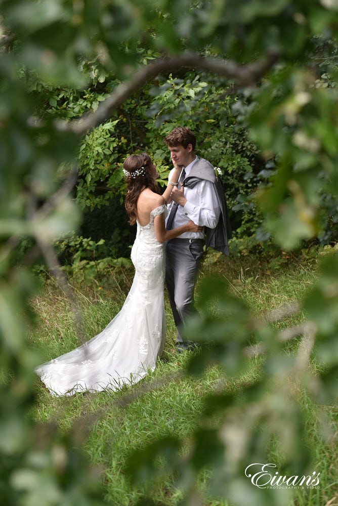 Hidden behind a beautiful and mysterious tree is the loving couple spending a precious moment together.