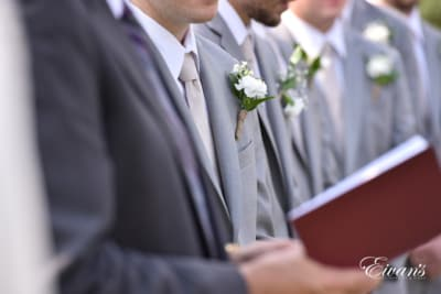 The groom stands at the alter awaiting his bride so they can begin their new life's together.