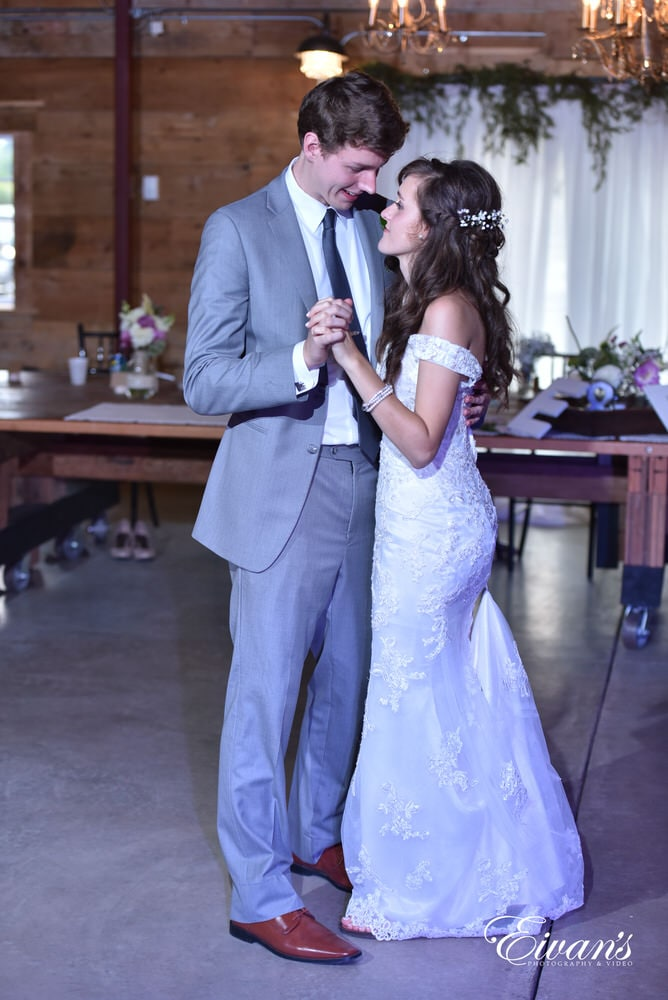 The bride and groom share their first dance together knowing this moment will be one they will never forget.