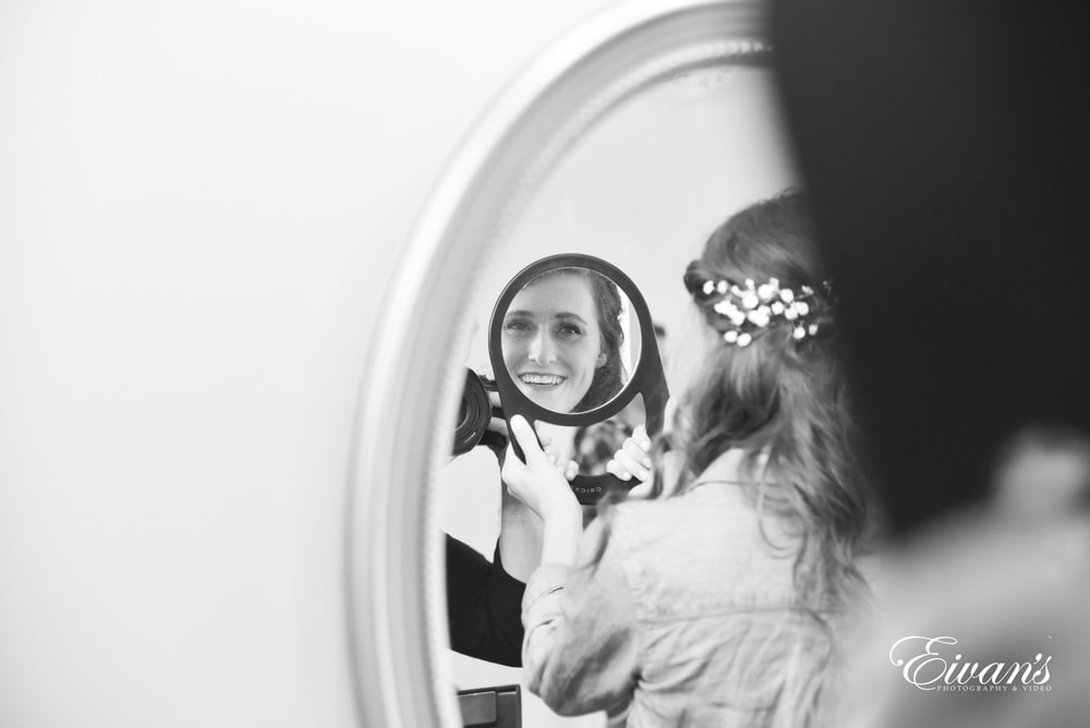 The bride admires her fabulous look for her special day.