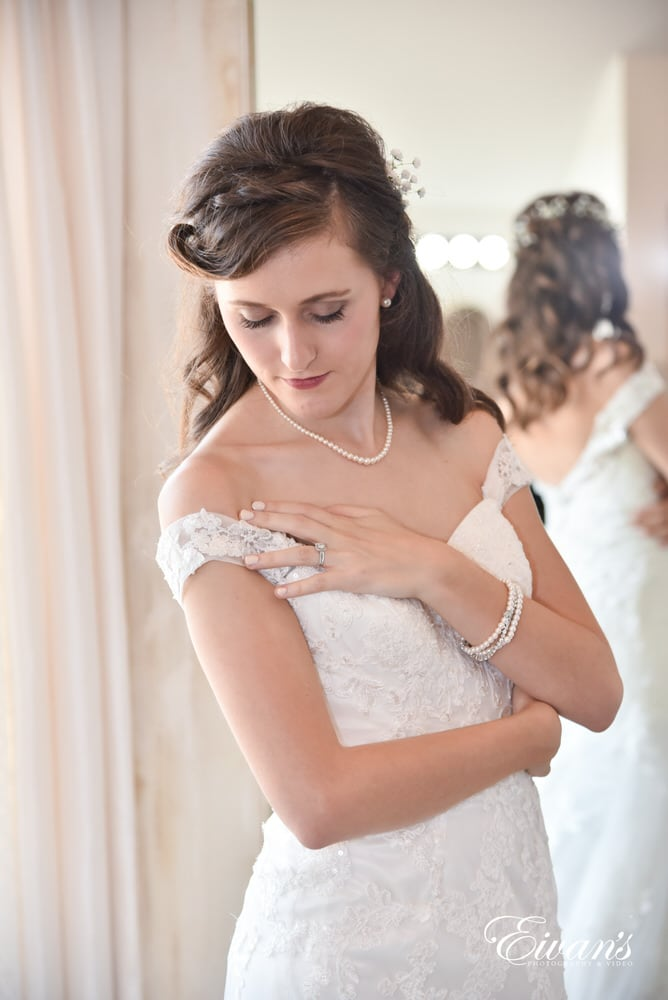 The bride stands preparing for her moment down the isle to proclaim her love to her dearly beloved.
