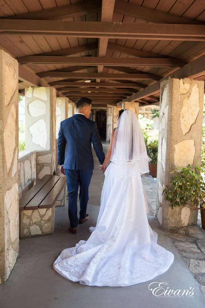 The couple walk together as they first see each other on such a stupendous day.