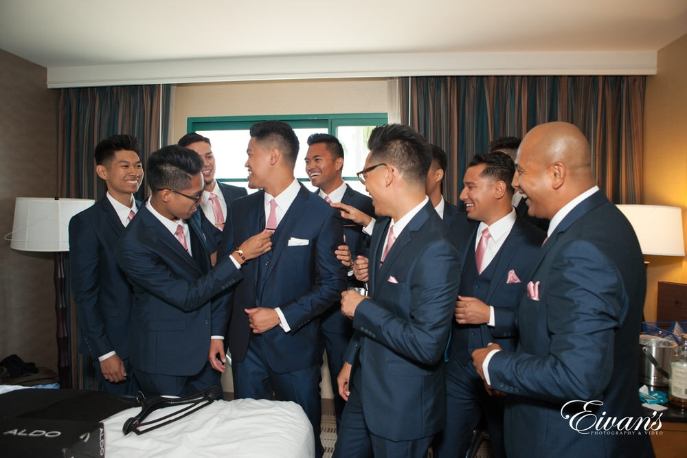 The groom prepares for his day with his best friends to celebrate this beautiful and amazing moment.