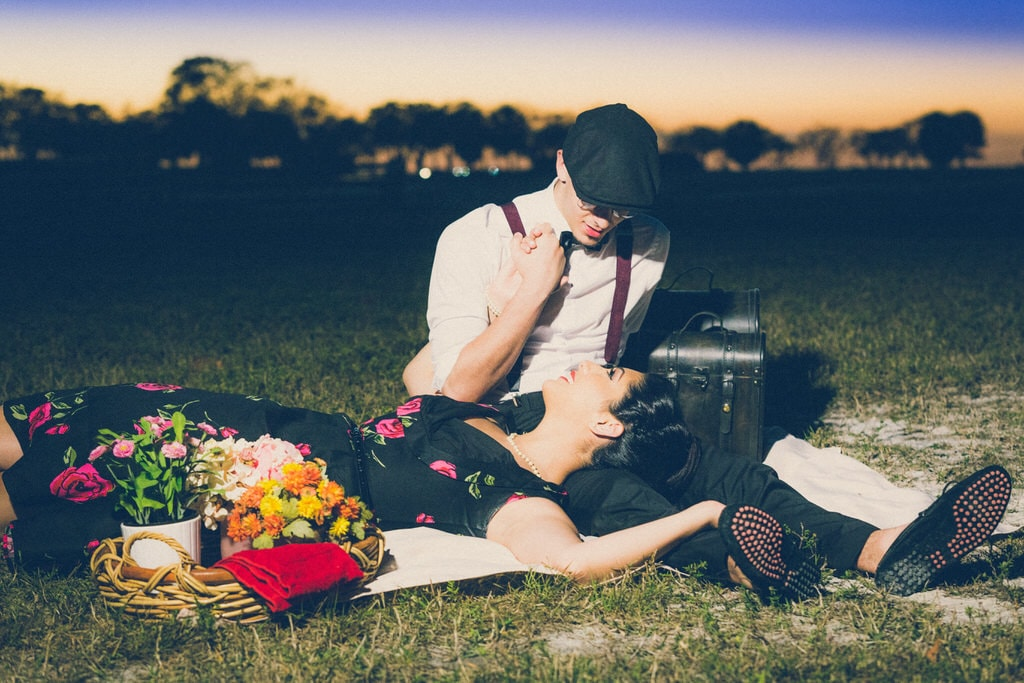 The vintage looks worn by this couple truly encompasses their particular style. To help truly capture this antique look the couple had old film cameras and beautiful flowers.