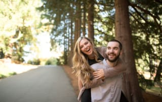 The gorgeous woods and even more stunning couple celebrate their never ending love while the soon-to-be groom carried his fiance on his back while they smile and laugh their worries away.
