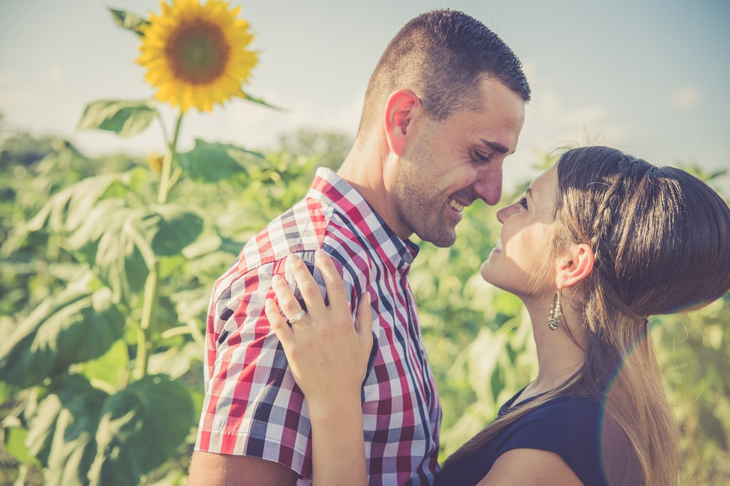 The bright yellow sunflowers and vibrant sun flares help encompass the beaming happiness this couple is feeling while they take their gorgeous engagement photos. The stunning smiles the couple have really show you just how much this couple loves one another.
