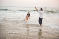 This beautiful couple is captured in a candid moment by this Eivan photographer as they play in the ocean just enjoying one another's company. You can see just how much they want to be together.