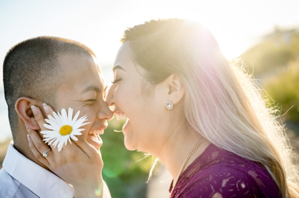 The couple is nose to nose and laughing.
