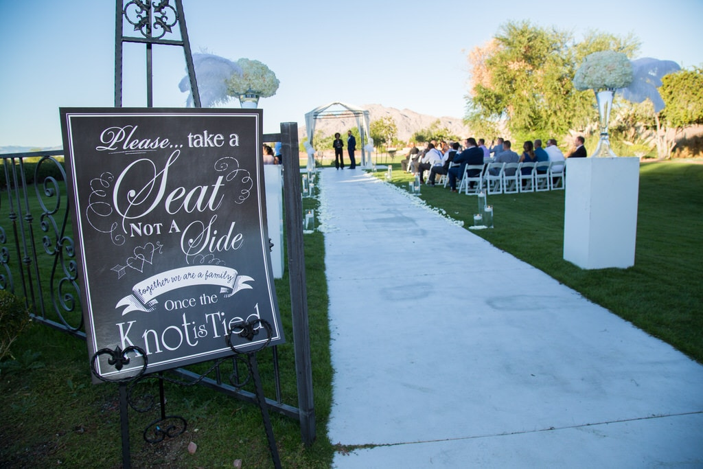 Eivan's Photographer captures the entryway sign indicating that wedding guests should take a seat and not a side.
