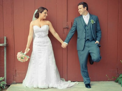 Bride and groom holding hand on their wedding day.