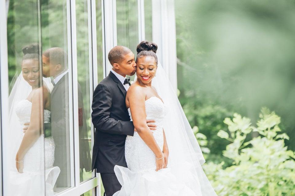 newlywed groom hugging bride from behind, atlanta wedding photographer portfolio