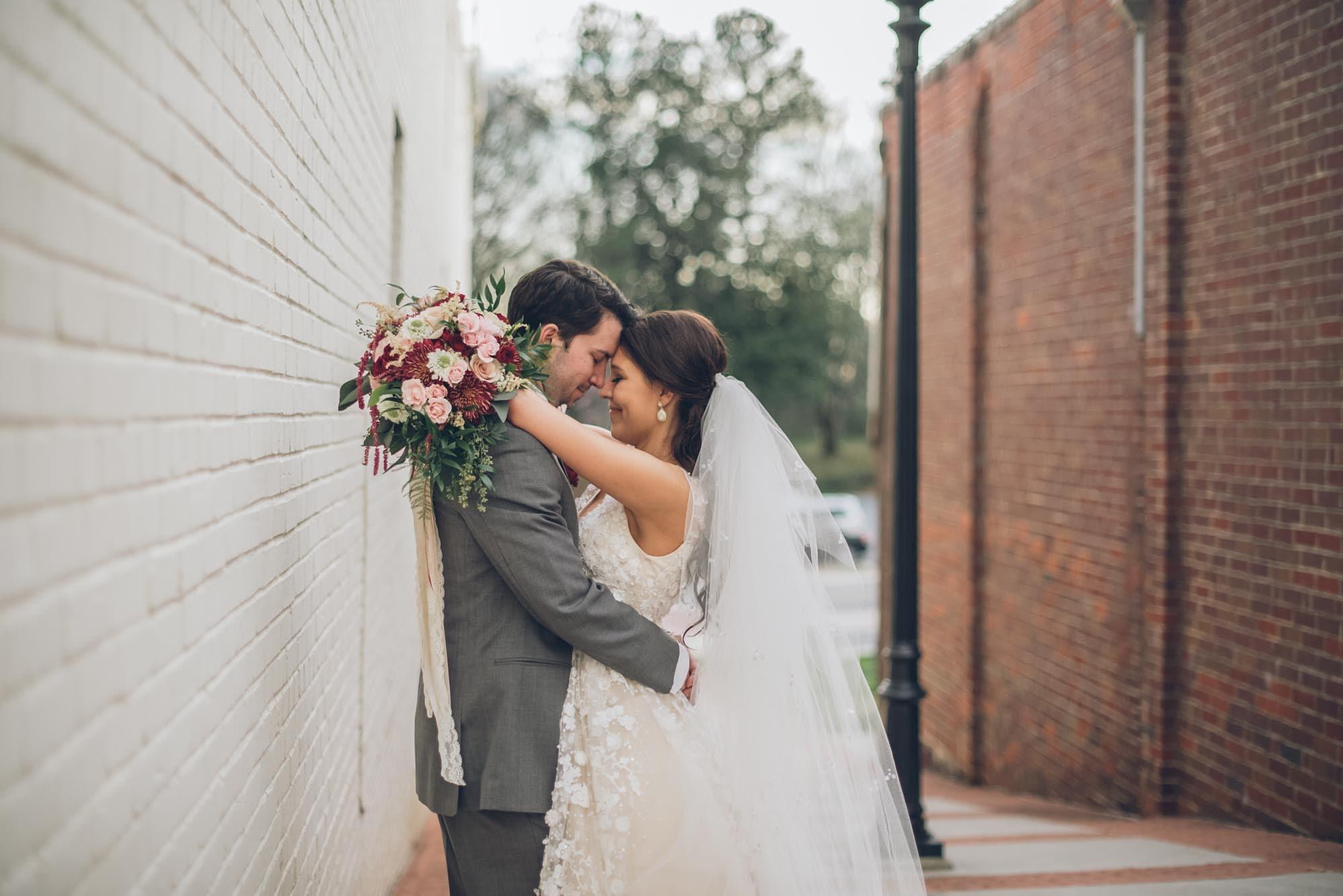 newlyweds posing in an alleyway, photographed by Eivan's in Atlanta
