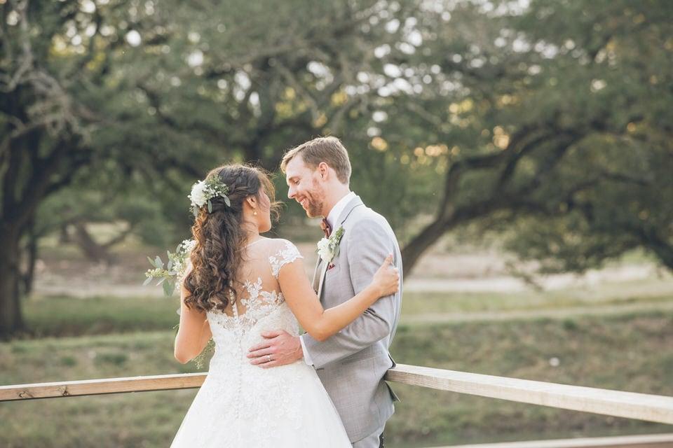 newlyweds dance on balcony, austin wedding photographer availability