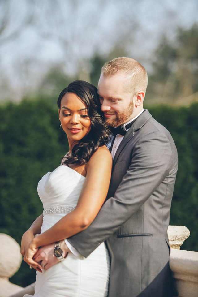 newlywed groom hugging bride from behind, boston wedding photographer packages and pricing