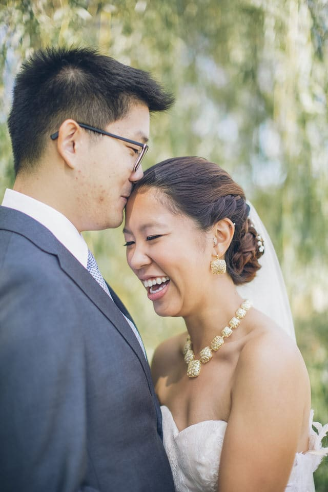 newlyweds forehead rest and smiling, boston wedding photographer availability