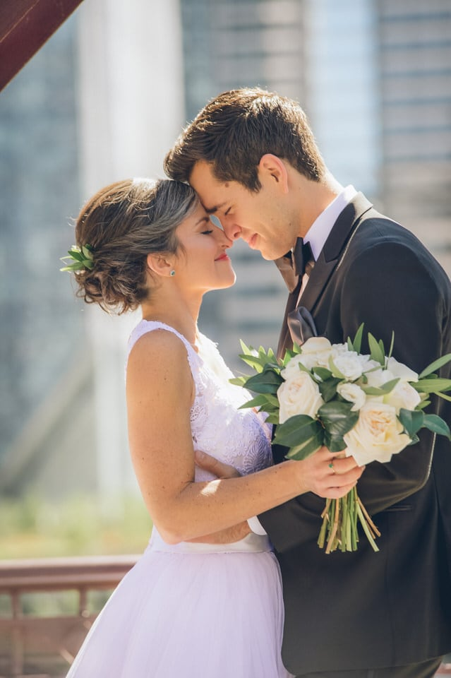 wedding couple pose for a portrait in downtown Chicago