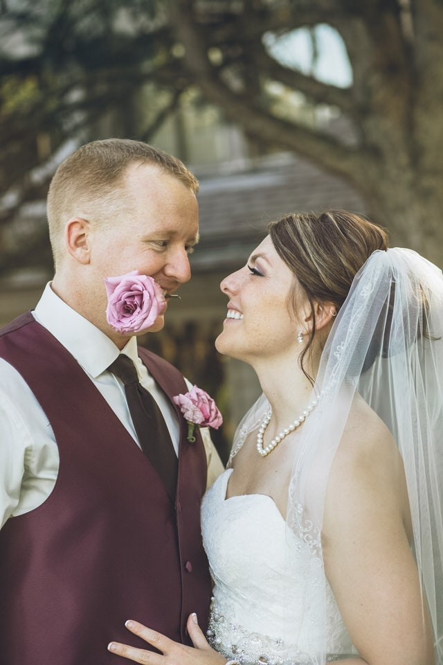 newlyweds looking into each others eyes, columbus wedding photographer packages and pricing