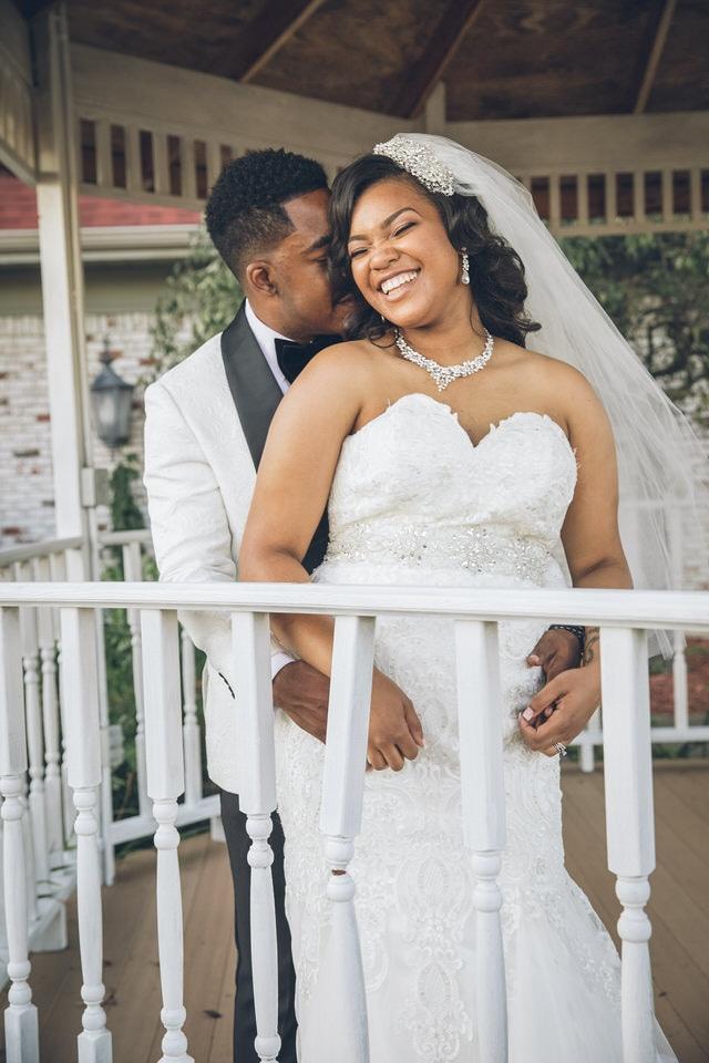 newlywed groom hugging bride from behind, columbus wedding photographer portfolio