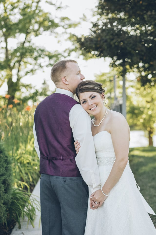 newlywed bride rests head on grooms shoulder, columbus wedding photographer availability