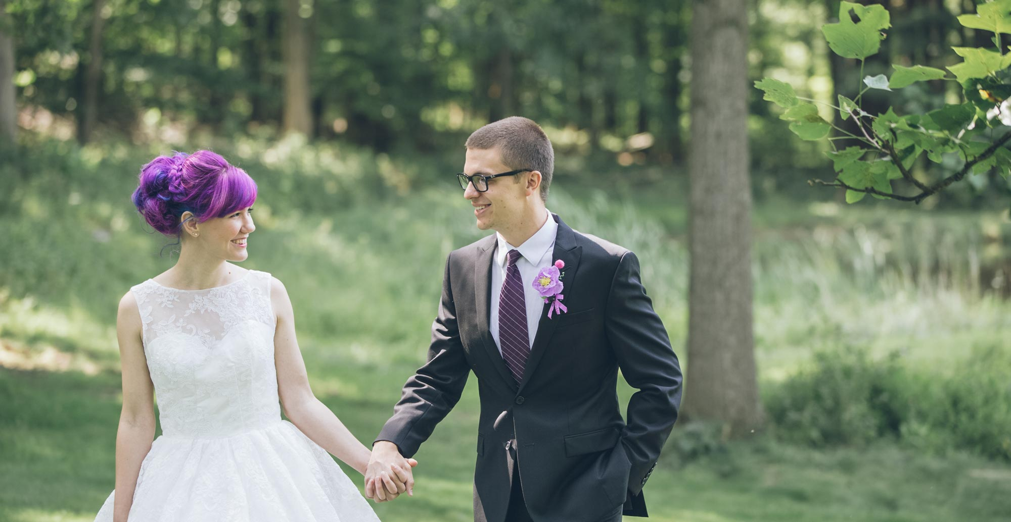 newlyweds holding hands, photographed by Eivan's in Columbus