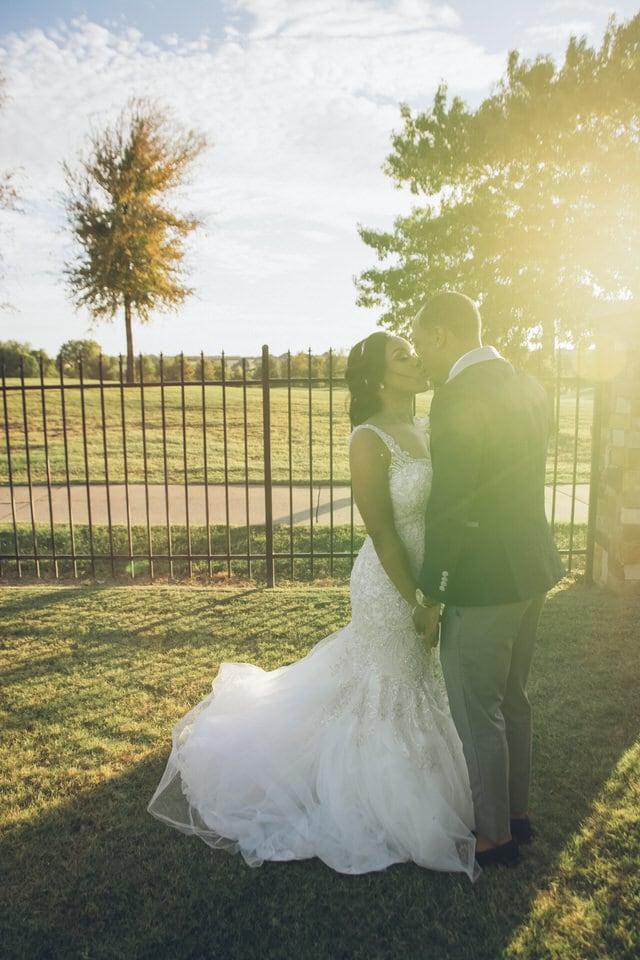 newlyweds kissing during sunset, dallas wedding photographer packages and pricing