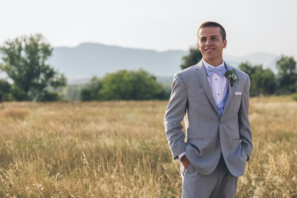 newlywed groom in a yard, denver wedding photographer packages and pricing