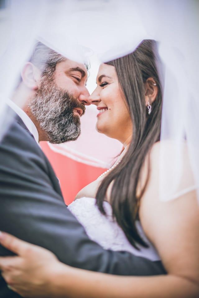 newlyweds sharing a nose kiss, houston wedding photographer availability