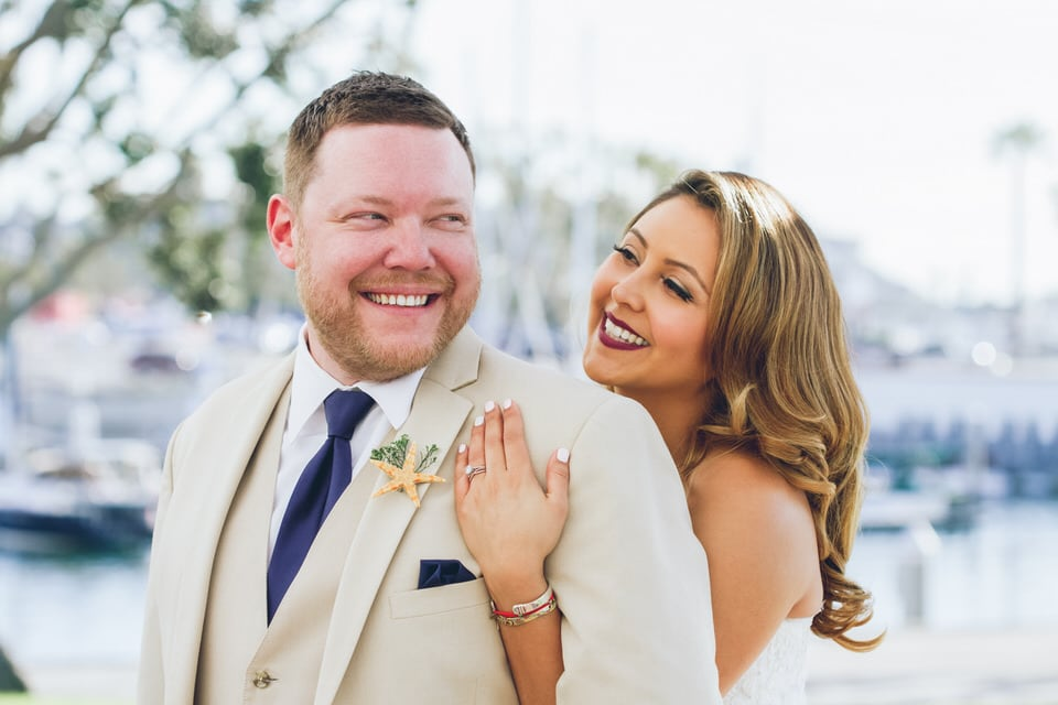 bride hugging groom from behind, los angeles wedding photographer packages and pricing