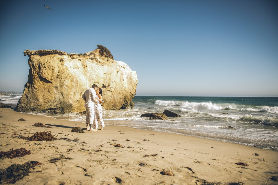 newlyweds on the beach, los angeles wedding photographer availability