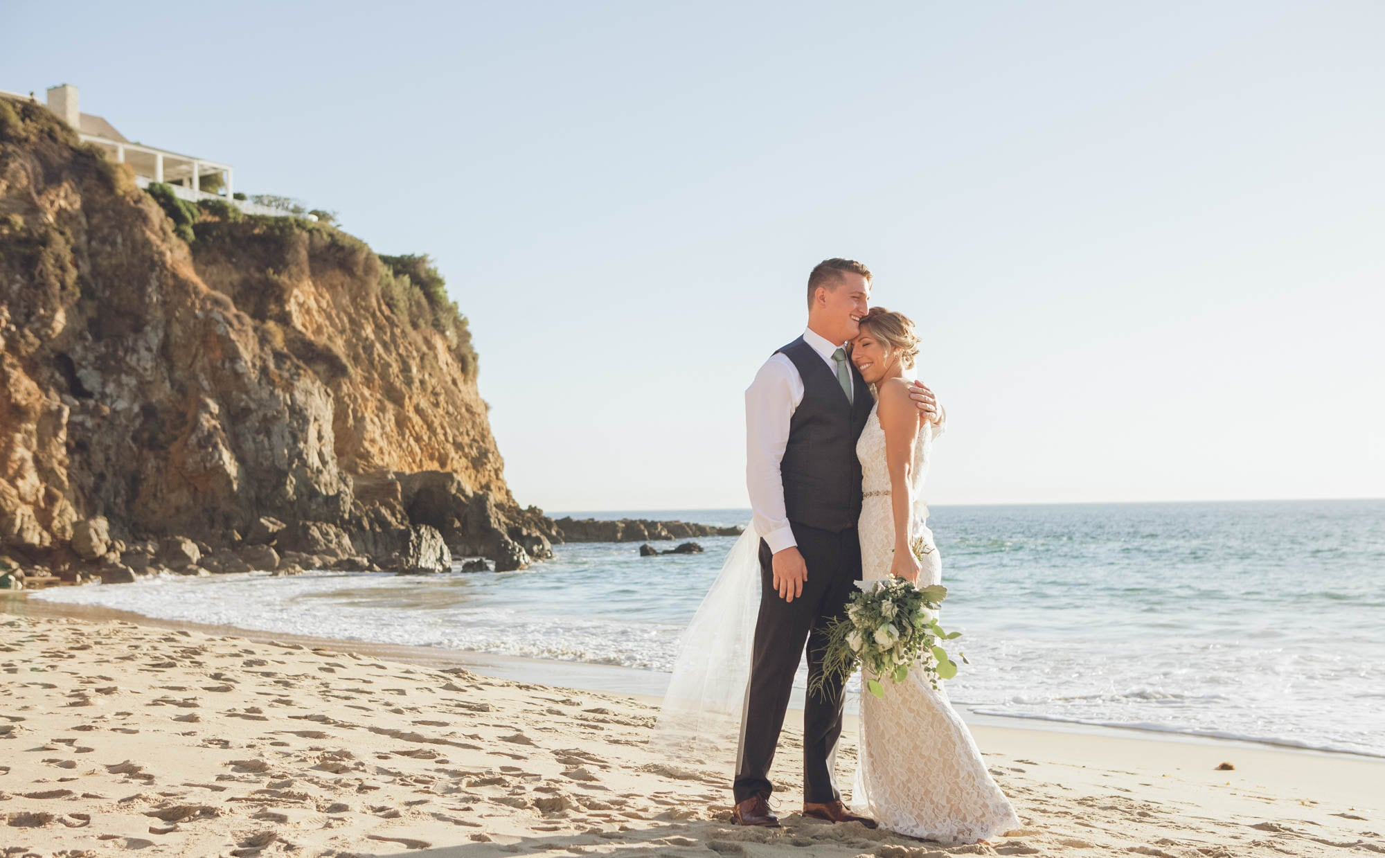 newlyweds in love on the beach, photographed by Eivan's in Los Angeles