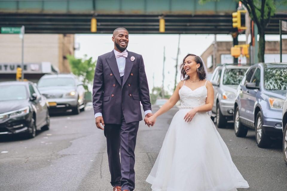 newlyweds walking in the streets, new york city wedding photographer portfolio
