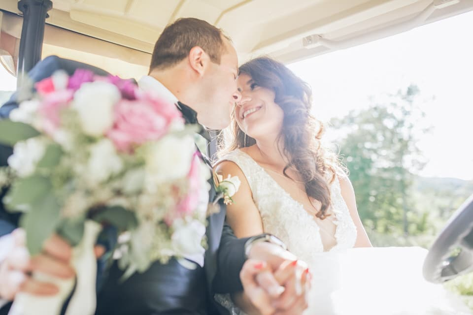 newlyweds in a carriage, new york city wedding photographer packages and pricing