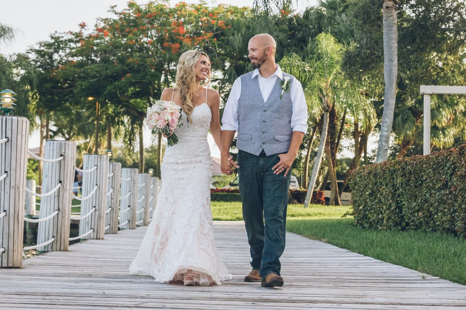 newlyweds walking hand in hand, miami wedding photographer availability
